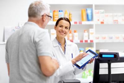 pharmacist introducing elder man to medicare